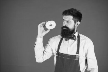 Bearded man in chef apron.