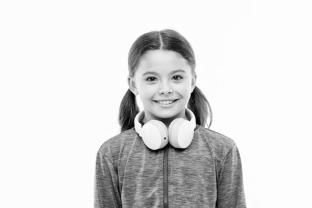 Little girl wearing headphones isolated on white. Stock Photo - 129262298