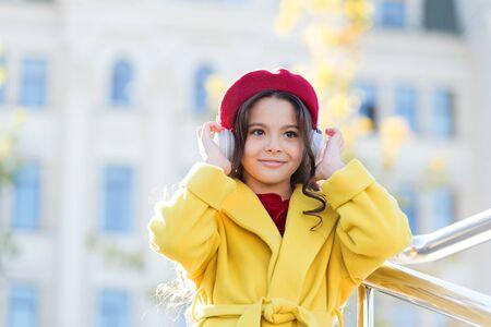 Girl kid with headphones urban Stock Photo