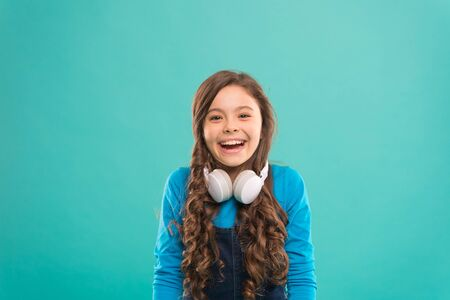 Happy little DJ on blue Stock Photo