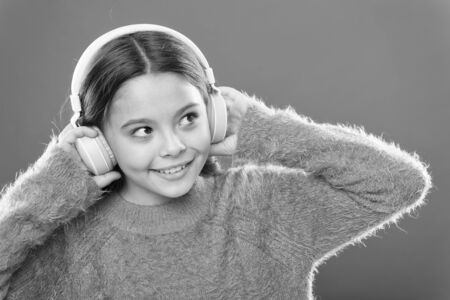 Small child wearing headphones Zdjęcie Seryjne