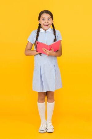 Happy little girl in retro uniform.