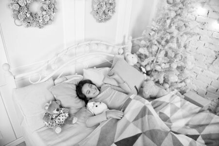 Child waiting for christmas in bedroom.