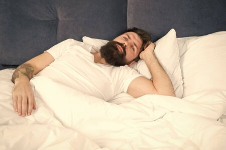 Man bearded hipster having problems with sleep.
