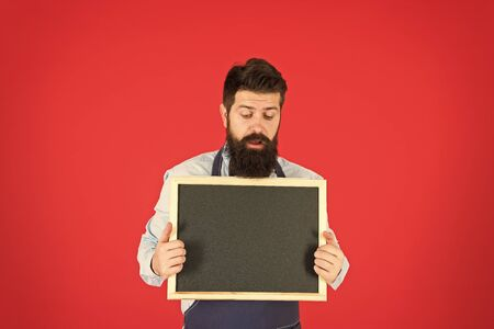 Sorry we are closed. Hipster bartender show blackboard copy space. Hipster restaurant staff. Hipster informing you. Man bearded bartender or cook in apron hold blank chalkboard. Price list concept. Stockfoto