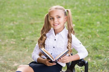 Secondary school student. Study language. Cute smiling small child hold book. Adorable little girl school student. School education concept. Cute little bookworm. Knowledge day. Ready for lessons.