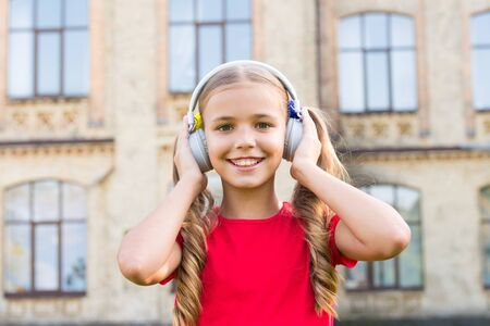 Cute kid with wireless headset. Stock Photo - 129248446