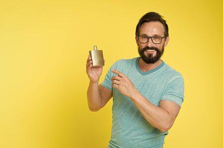 Man bearded handsome hold bottle perfume. Stok Fotoğraf