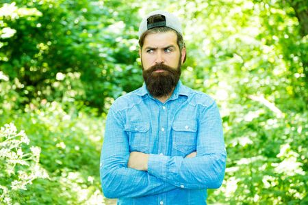 Mature hipster with beard. male facial care.