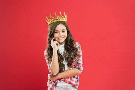 Source of pride. Proud little girl wearing crown jewel with pride on red background. Adorable small child with long curly hair feeling great pride. Pride concept