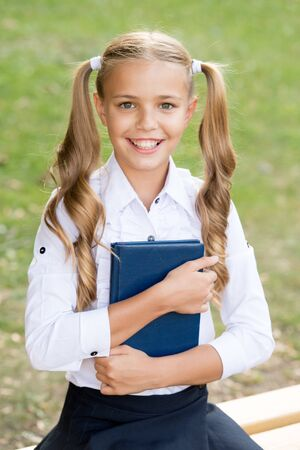 Study language. School education concept. Cute little bookworm. Knowledge day. Ready for lessons. Secondary school student. Cute smiling small child hold book. Adorable little girl school student