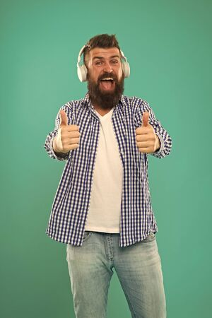 Excellent sound. Music library concept. Tech gadgets all music lovers should have. Music always with me. Man listening song in headphones. Best gifts for music lovers. Bearded hipster wear headphones Stock Photo - 129257796