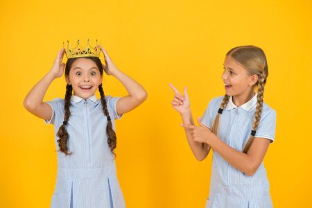 Little princess. Motivational award for school children. Succeed in education. Celebrating success. She is the best. Happy schoolgirls and golden crown symbol of success. Success and respect Stock Photo