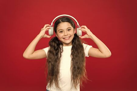 Powerful effect music teenagers their emotions, perception of world. Girl listen music headphones on red background. Modern gadget concept. Music taste. Music plays an important part lives teenagers Stock Photo - 129257806