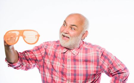 Carefree emotional pensioner concept. Man senior bearded hipster wear striped sunglasses. Having fun. Eyes care. Ageing and eyesight. Diagnostics eyes disease age changes. Eyes health. Optics store