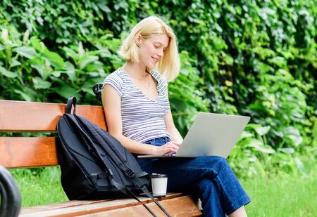 Modern student life. Regular student. Surfing internet. Girl adorable student with laptop coffee cup and backpack sit bench park. Woman student work with notebook. Learn study explore. Study outdoors 스톡 콘텐츠 - 129416529