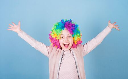Happiness is living life from the inside out. Happy little girl child wearing bright wig hair smiling with happiness. Childs happiness and well being. There is no beauty without happiness