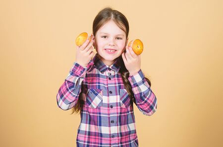 Simple and sweet food and snack. Cute little child holding home baked cupcake food in hands. Adorable small girl with freshly baked dessert food. The most tempting sugary food Stock Photo - 129417000