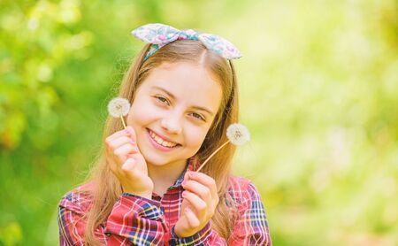 happy child hold blowball. dandelion. Spring holiday. Womens day. Natural beauty. Childhood happiness. summer vacation. Rancho and country. little girl and with taraxacum flower. happy childhood