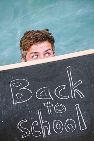 Are you ready study. Teacher or school principal welcomes inscription back to school. Educator hiding behind blackboard. Teacher peeking out blackboard. Prepare school year. Education opportunities