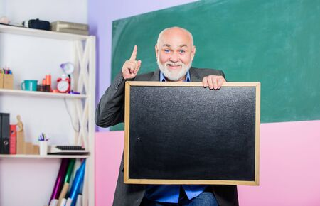just inspired. exam and graduation results. place for copy space. Mature teacher man hold chalk board. information is here. senior man teacher with empty blackboard. back to school. Education concept Reklamní fotografie