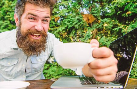 brutal bearded hipster at coffee break. happy man working on laptop. perfect deal. office worker. Successful businessman. agile business. Business success. We did it