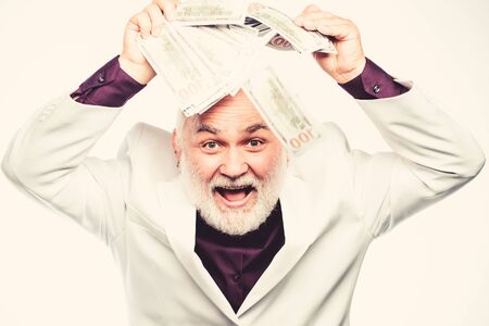 Bank concept. rich mature man has lots of money. retirement. Happy lottery winner. business success. Richness. mature bearded man with dollar banknotes. successful businessman