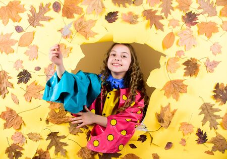 Fall fashion. Kid girl happy wear waterproof cloak. Waterproof accessories make rainy fall day cheerful and pleasant. Enjoy fall weather with proper garments. Waterproof accessories for children Foto de archivo - 129823373