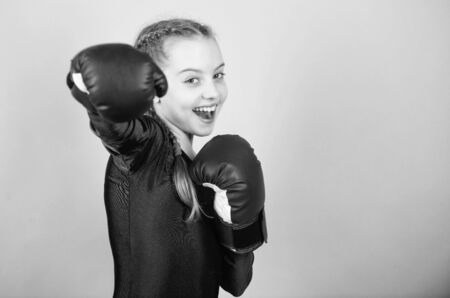 Feminism concept. With great power comes great responsibility. Boxer child in boxing gloves. Girl cute boxer on blue background. Rise of women boxers. Female boxer change attitudes within sport