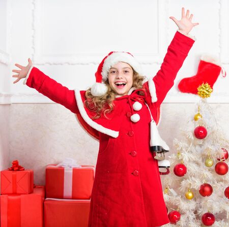 Winter holidays concept. Enjoy christmas holidays. Child red santa costume ready to celebrate. Merry christmas and happy new year. Christmas tradition holiday. Top christmas celebration ideas Imagens