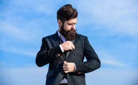 Just right. Flawless outfit. Man formal suit adjusting jacket. Male fashion formal menswear. Fashion trend. Guy beard and mustache wear formal clothes. Businessman bearded face sky background Zdjęcie Seryjne