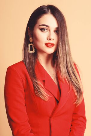 Red lips my best accessory. Girl confident business lady formal red jacket. Gorgeous and stylish. Impeccable makeup and perfect jewelry. Red suits her. Pretty woman make up face red sensual lips
