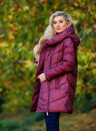 Girl fashionable blonde walk in autumn park. Jackets everyone should have. Best puffer coat to buy. How pick puffer jacket. Puffer fashion concept. Professional stylist advice. Woman wear warm jacket Zdjęcie Seryjne - 129253636