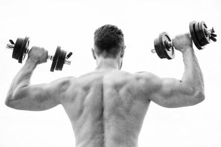 Actions speak louder than coaches. Dumbbell exercise gym. Muscular man exercising with dumbbell rear view. Sportsman with strong back and arms. Sport equipment. Bodybuilding sport. Sport lifestyle Stock Photo
