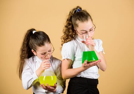 science research in lab. knowledge and education. little smart girls with testing flask. back to school. children study at biology lesson. school lab. working in lab. bilogy lab for curious children