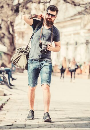 Manual settings. Photographer with beard and mustache. Tourist shooting photos. Content creator. Man bearded hipster photographer. Old but still good. Photographer hold vintage camera. Modern blogger Foto de archivo - 129431555