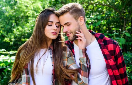 My couple. valentines day. summer camping in forest. family weekend. romantic date. man and woman in checkered shirt relax in park. hipster couple outdoor. couple in love. Hiking Фото со стока