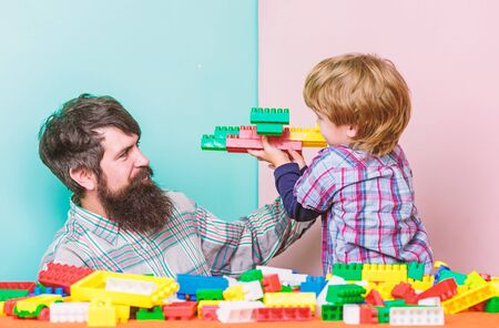 father and son play game. Dream about fly. happy family leisure. building plane with colorful constructor. love. child development. small boy with dad playing together. Thats OK. I did it