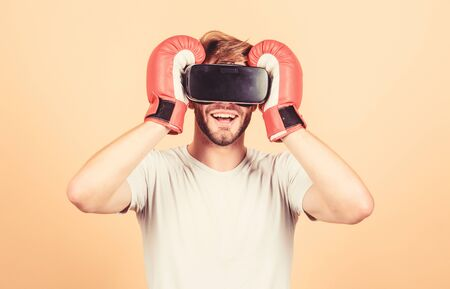 Modern technologies. man use new technology. boxing in virtual reality. Digital sport success. vr boxing. future innovation. modern gadget. Training boxing game. man in VR glasses. Futuristic gaming