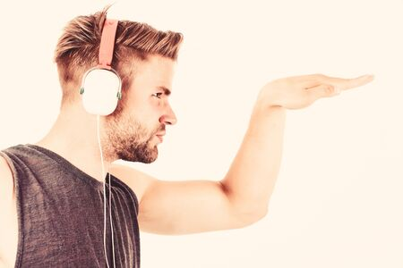 Start this party. Professional musical software and devices. Cheerful dj full of energy. Entertainment concept. Music drives him dance. Equipment for dj. Man handsome dj using modern headphones