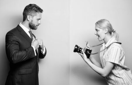Photosession for business magazine. Handsome businessman posing camera. Nice shot. Fame and success. Businessman enjoy star moment. Photographer taking photo successful businessman. Paparazzi concept