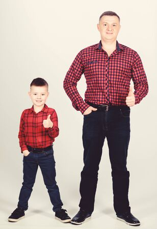 little boy with dad man. success. thumb up gesture. happy family. childhood. parenting. fathers day. father and son in red checkered shirt. on ranch. You are my treasure. You are my everything