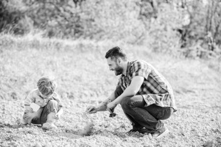 Eco living. happy earth day. Family tree. father and son planting flowers in ground. new life. soils fertilizers. rich natural soil. Eco farm. small boy help father in farming. earth day. earth day Stock Photo