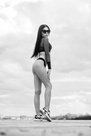 perfect body with no cellulite and fat. sport and fitness. Sky. woman with fit body. freedom. sensual girl in underwear and sunglasses outdoor. summer fashion beauty. Big ass. gorgeous bum