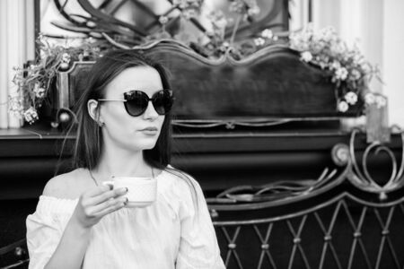 Caffeine dose. Coffee for energetic successful day. Breakfast time in cafe. Girl enjoy morning coffee. Woman drink coffee outdoors. Peaceful inspiring moment. Girl relax in cafe cappuccino cup