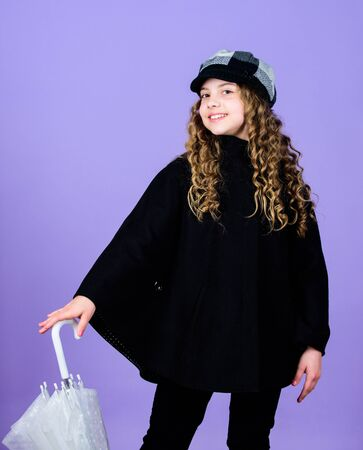little girl in french beret and coat. autumn fashion. cheerful hipster child in positive mood. rain protection. Rainbow. happy little girl with transparent umbrella. School time. Time to relax Reklamní fotografie