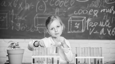Future scientist. Explore and investigate. School lesson. Girl cute school pupil play with test tubes and colorful liquids. School chemical experiment. School education. Interesting approach to learn Stock fotó