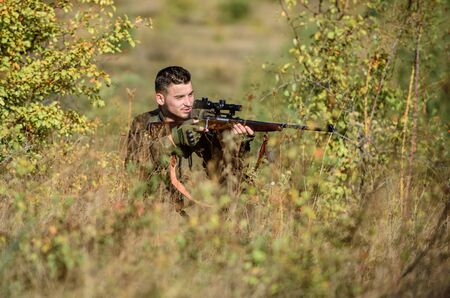 Hunting permit. Hunting is brutal masculine hobby. Hunting equipment for professionals. Bearded serious hunter spend leisure hunting. Hunter hold rifle. Man wear camouflage clothes nature background