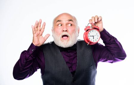 Counting time. time management. business startup. mature man with beard clock show time. mature bearded man with alarm clock. retirement. watchmaker or watch repairer. time and age. Timekeeping 写真素材