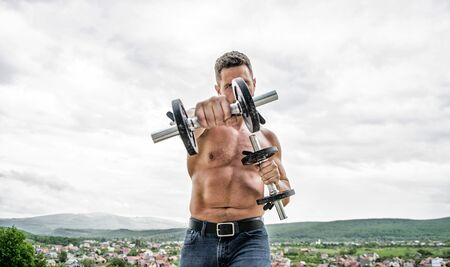You can do it Muscular man exercising in morning with barbell. fitness and sport equipment. man sportsman with strong hands. steroids. athletic body. Dumbbell gym. success. Perfect biceps